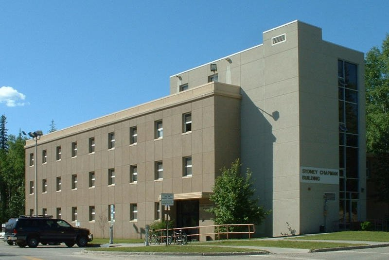 The Chapman Building on the UAF Campus, a three-story rectangular building with rows of offices.